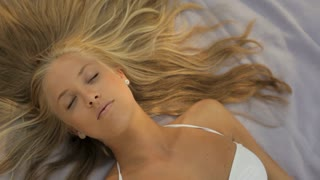 zoom in head and shoulders of young woman lying down