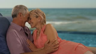 zoom in shot of senior couple relaxing by sea