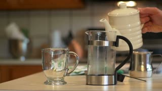 adding water to the french press slow motion