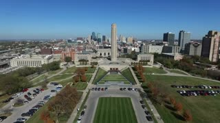 aerial push in to WWI museum with Kansas City in background