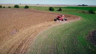 aerial push to soybean harvester in Kansas