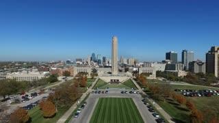 aerial tilt of WWI museum with Kansas City skyline