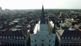 Aerial view pulling back from the St. Louis Cathedral New Orleans