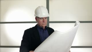 architect looking at drawings.