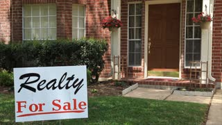 banker putting on foreclosure sign and knocking on door