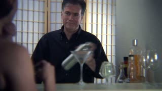 bartender mixing a drink for a woman