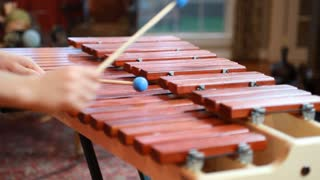 boy playing marimba