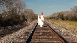 bride walking on railroad tracks