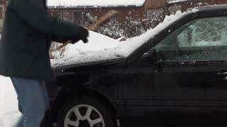 brushing snow of the car
