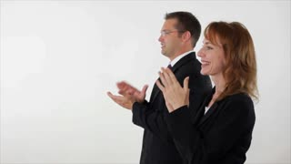 Business people clapping woman in front