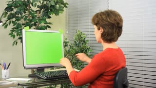 business woman working green screen monitor