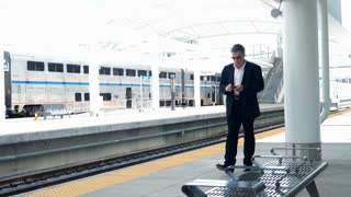 businessman at the train station 4k.