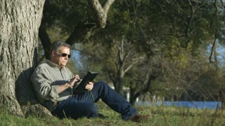 businessman finishes work and watches nature