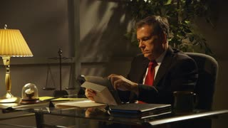 businessman or lawyer working at his desk.