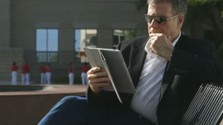businessman outdoor using his tablet pc