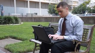 businessman park on laptop