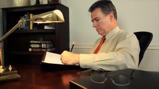 businessman taking notes