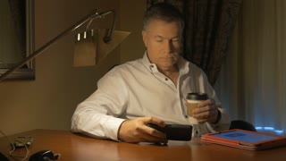 businessman working at his desk drinking coffee