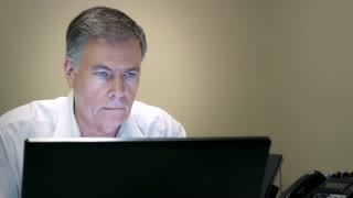 businessman working at his desk on a laptop 4k