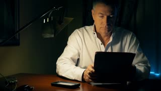 businessman working at his desk using a tablet pc