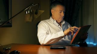 businessman working at his desk with a tablet pc and phone