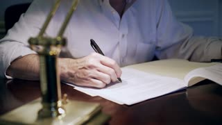 businessman working on paperwork turns off lamp 4k