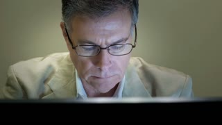 businessman working takes off glasses and smiles at camera 4k