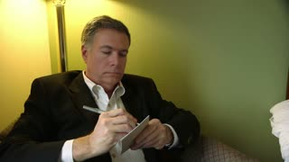 businessman writing notes.