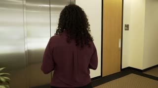 businesswoman getting on an elevator and the doors close 4k