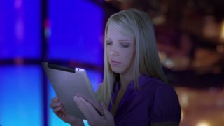 Businesswoman looking at a tablet pc