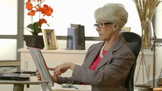 businesswoman or lawyer checking her tablet pc and smiles at camera