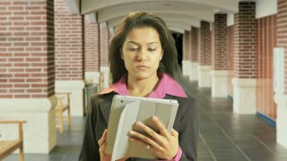 Businesswoman outdoor using a tablet