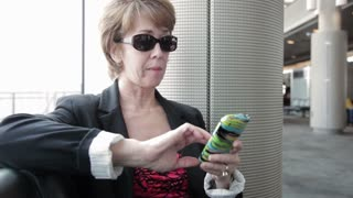 businesswoman texting in a airport