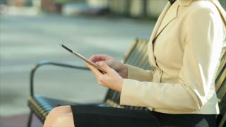 businesswoman using a tablet outside