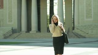 businesswoman walking downtown