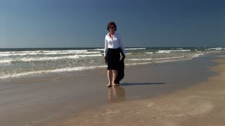 businesswoman walking in the waves
