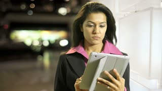 businesswoman with tablet pc in front of bright wall.