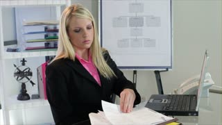 Businesswoman working and thinking