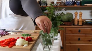 chef cutting herbs