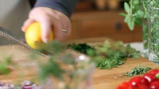 chef zesting a lemon