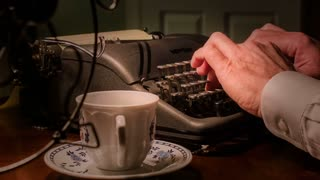 close shot of vintage writer using a typewriter.