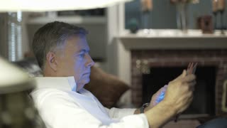 closeup man in his living room using a tablet pc 4k