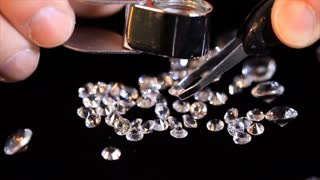 closeup of a jeweler looking at diamonds