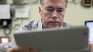 closeup of businessman using a digital tablet pc.