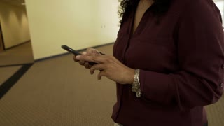 closeup of businesswoman in her office using a cell phone 4k