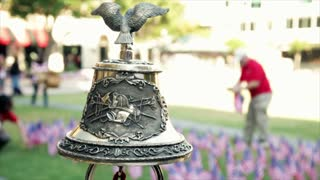 closeup of firefighter bell at 911 memorial
