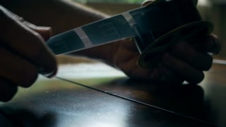 closeup of man looking at microfiche film 4k