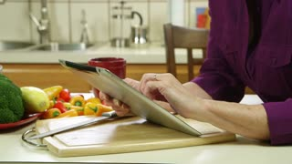 closeup of mature woman using a tablet pc.