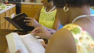 closeup of women reading bible.