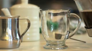closeup pouring coffee in a mug slow motion